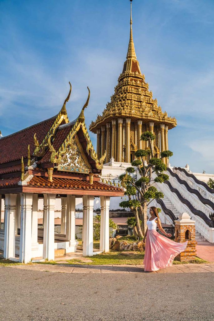 Girl in a pink dress standing in front of temples at the Ancient Siam Bangkok