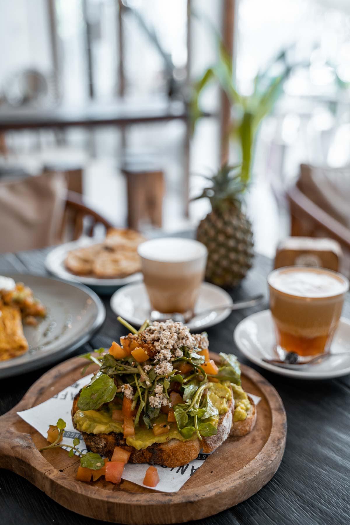 Breakfast with avocado toast at Cafe Organic in Canggu, Bali