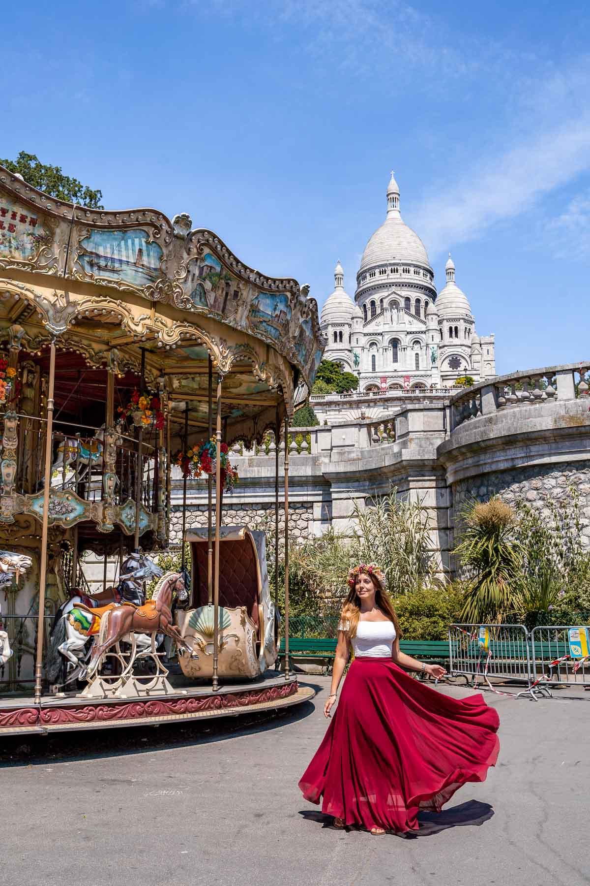 Girl in a red skirt twirling in front of Carrousel de Saint-Pierre in Montmartre, Paris