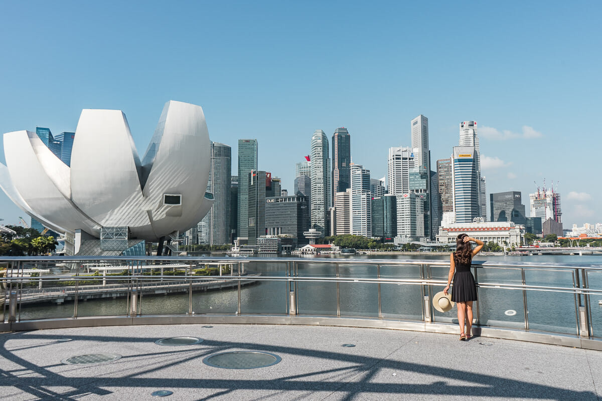 Girl in a black dress looking at the Marina Bay Skyline in Singapore