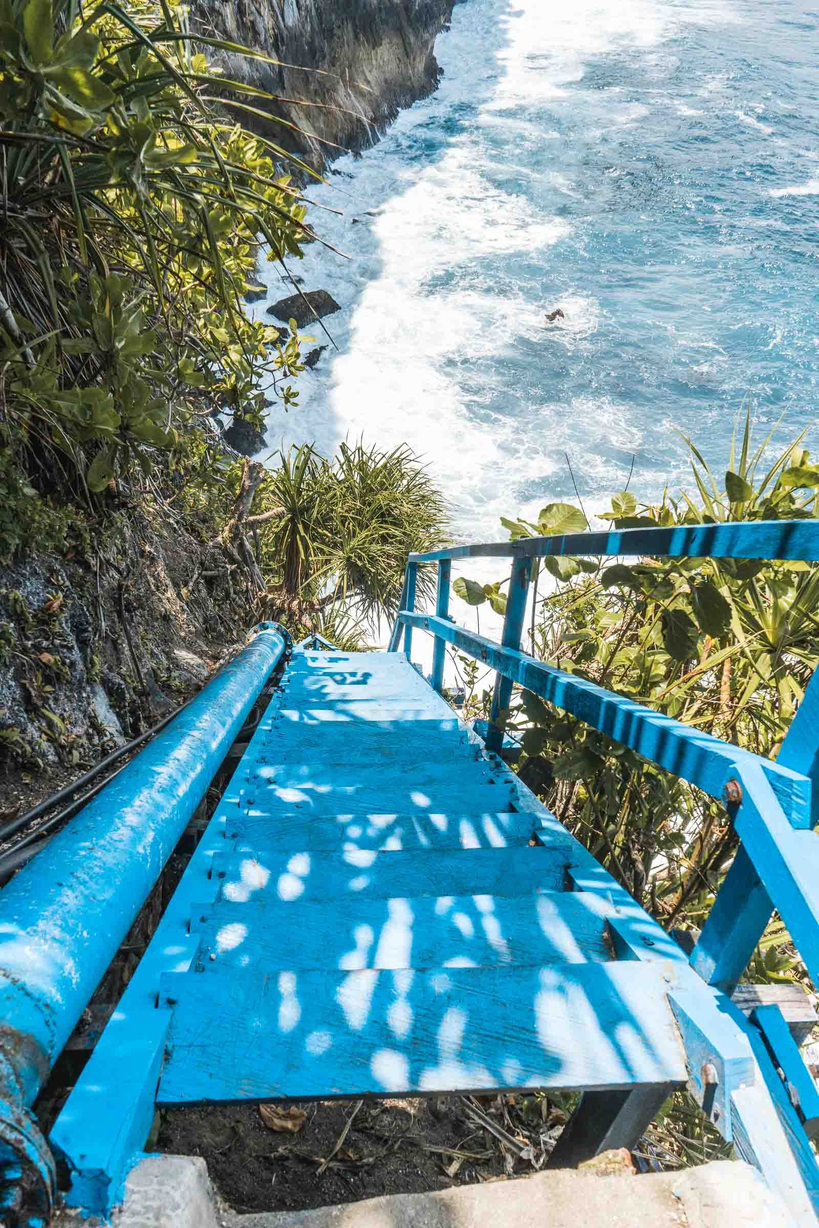 Blue stairway leading down to Peguyangan Waterfall, Nusa Penida
