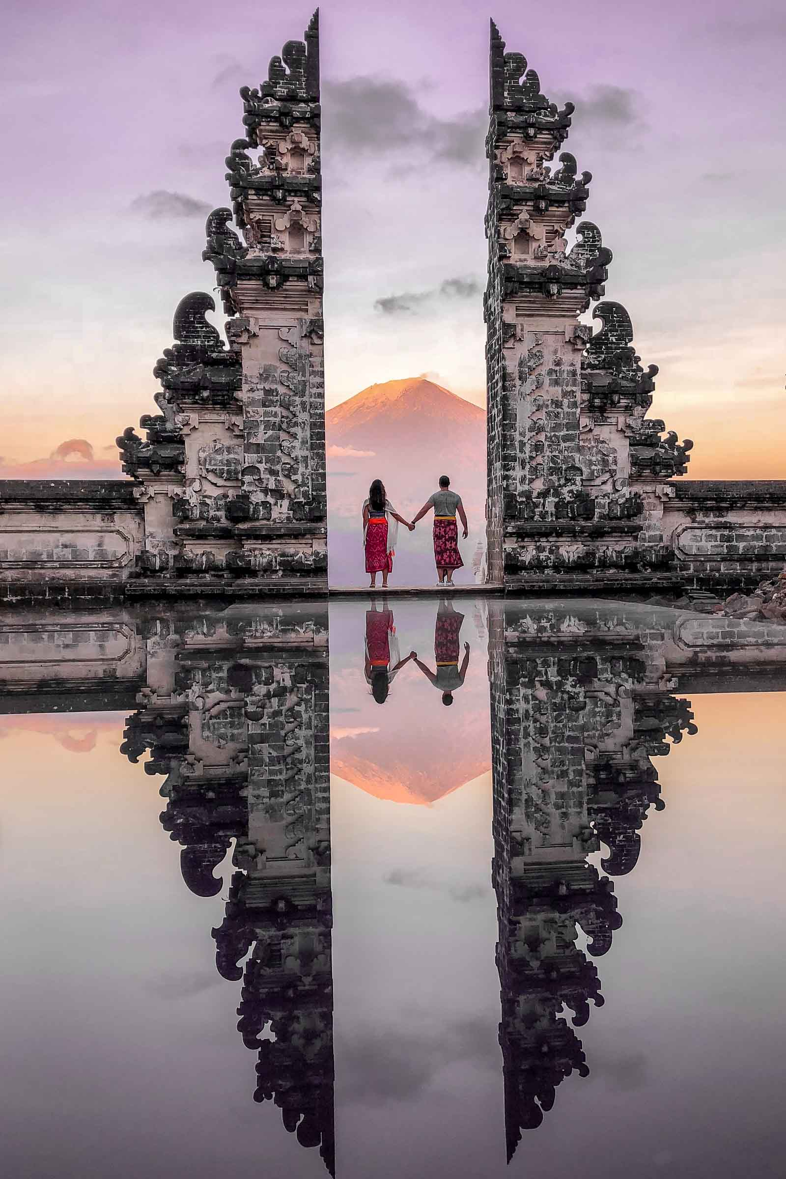 Girl and a boy standing at the Gates of Heaven at Pura Lempuyang in Bali