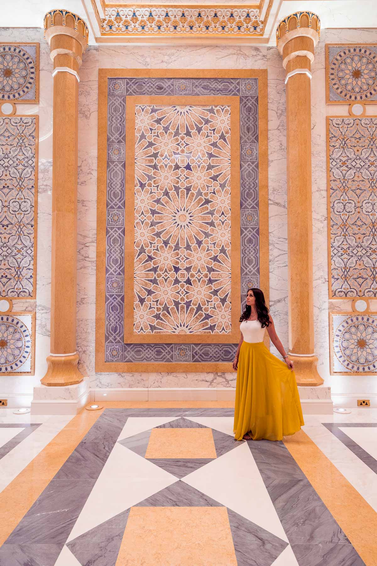 Girl in a yellow skirt standing in Qasr al Watan Palace, Abu Dhabi