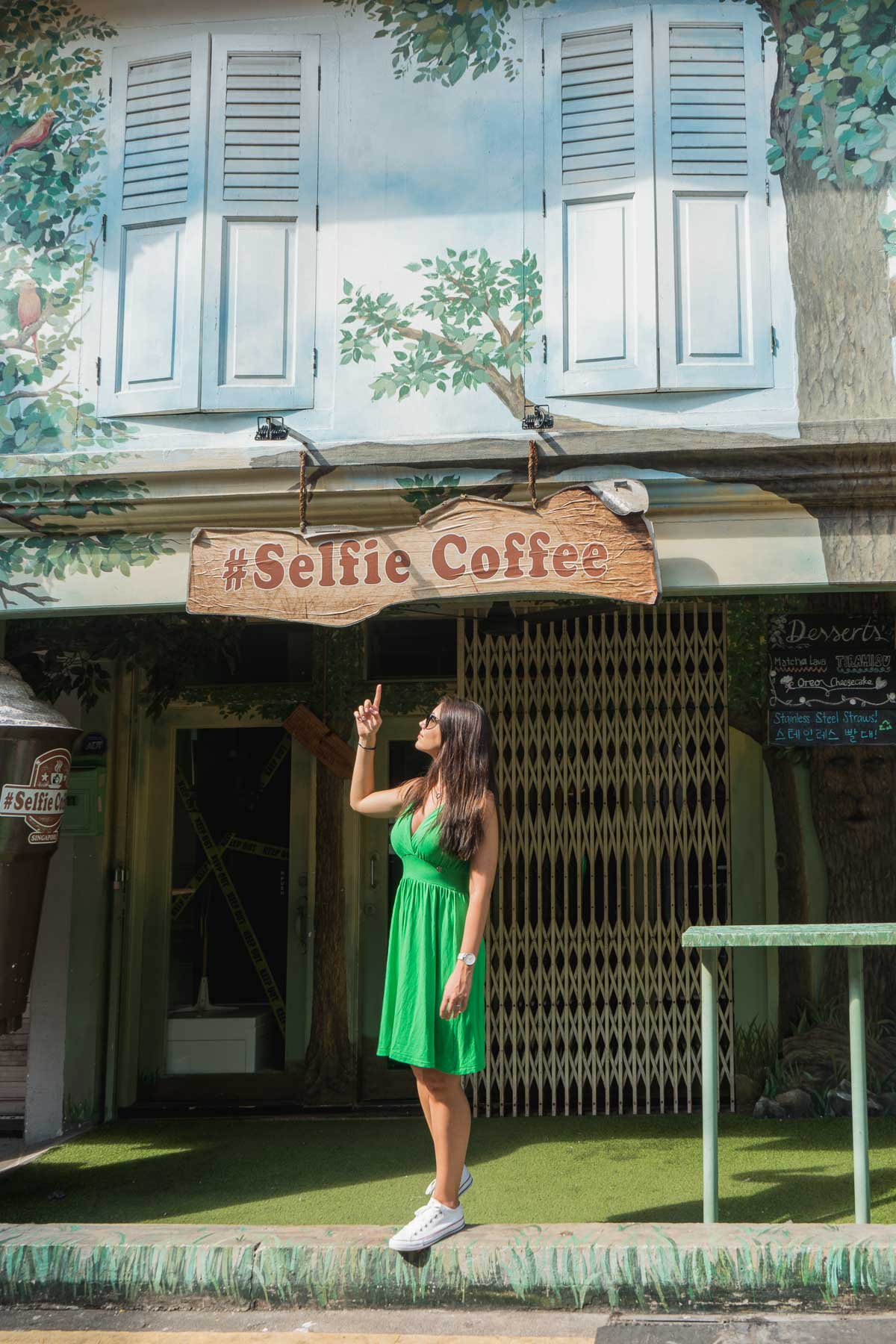 Girl in a green dress standing in front of the Selfie Coffee, Singapore