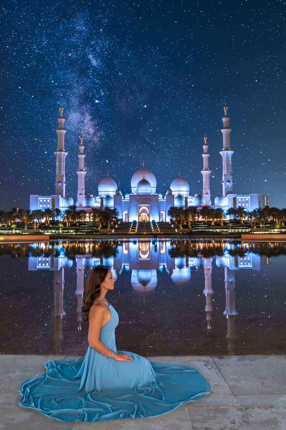 View of the Sheikh Zayed Grand Mosque at night with starry sky from Wahat al Karama, one of the most Instagrammable places in Abu Dhabi