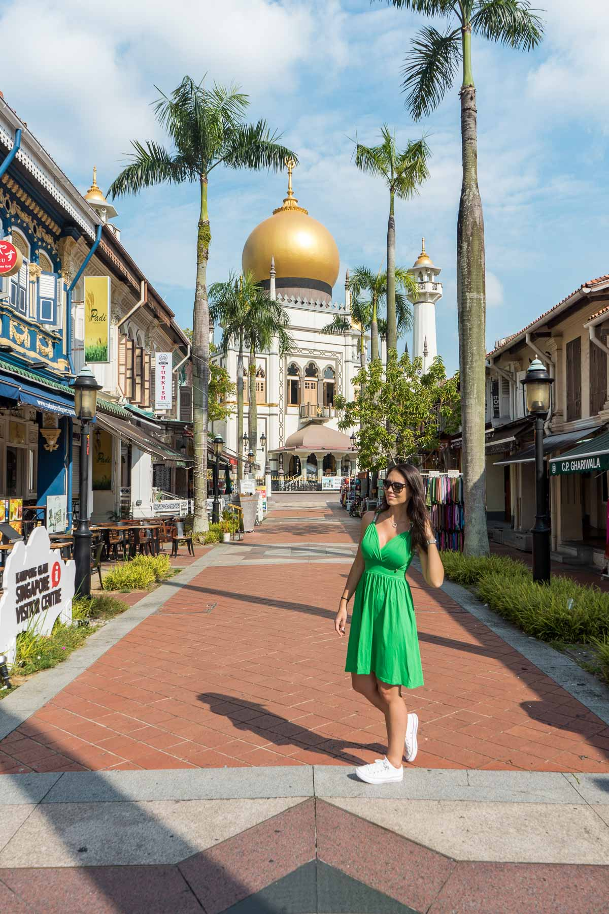 Girl in a green dress standing in front of the Sultan Mosque in Singapore