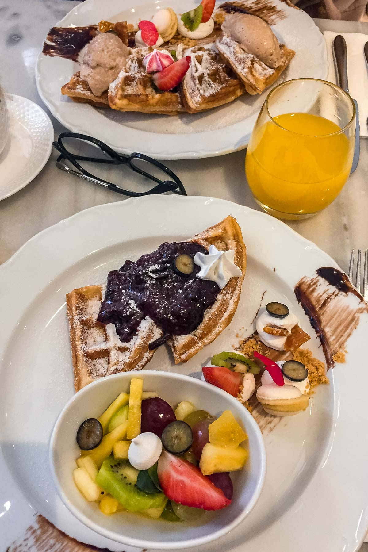 Waffles and fruits for breakfast at Á La Maison Grand Budapest