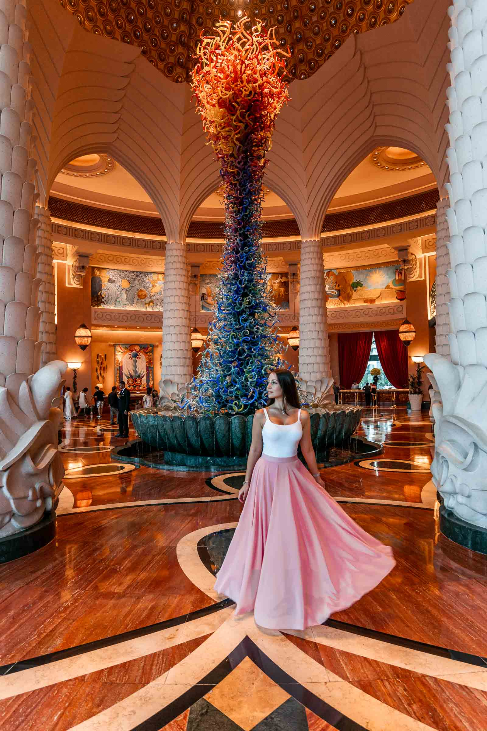 Girl in pink skirt standing in the lobby of the Atlantis hotel in Dubai