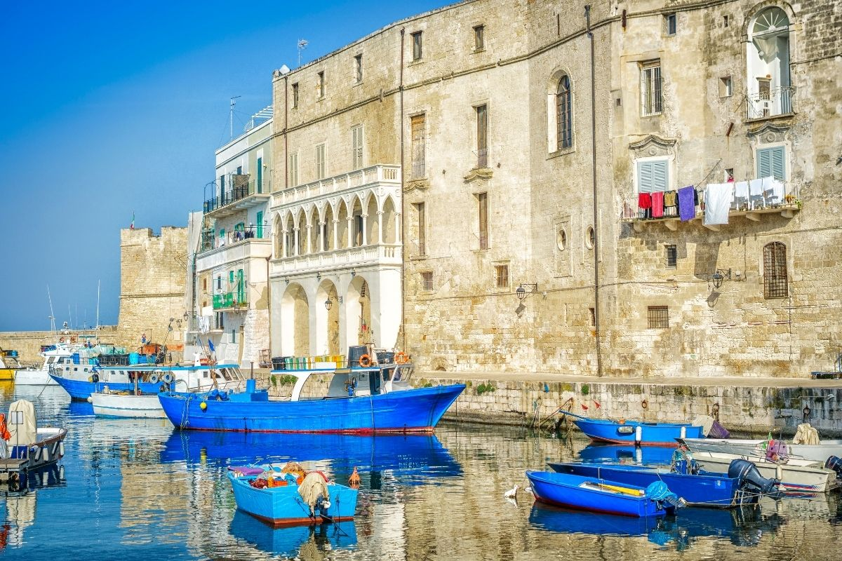 Blue boats in the seaport of Monopoli, Italy