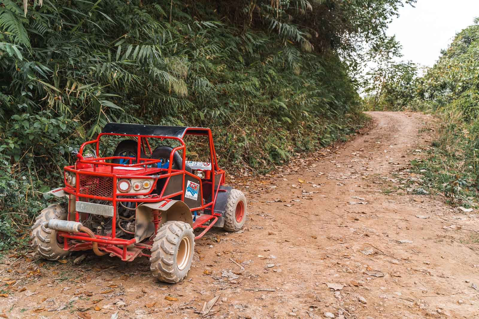 Red buggy on the roads in Vang Vieng