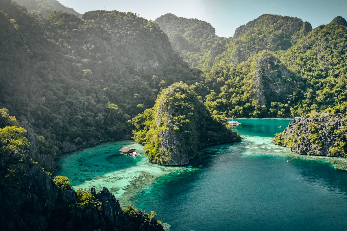 The view of the blue sea and the lush green mountains at Coron, Philippines