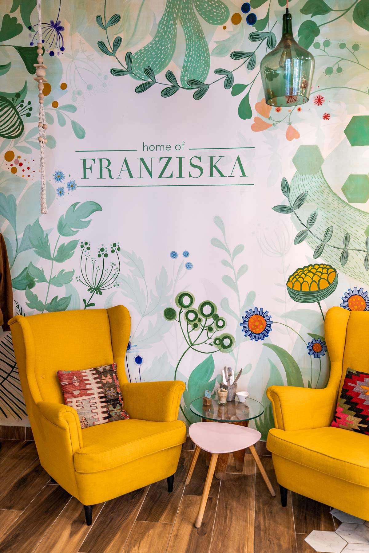 Interior with green walls and yellow armchairs at Home of Franziska in Budapest