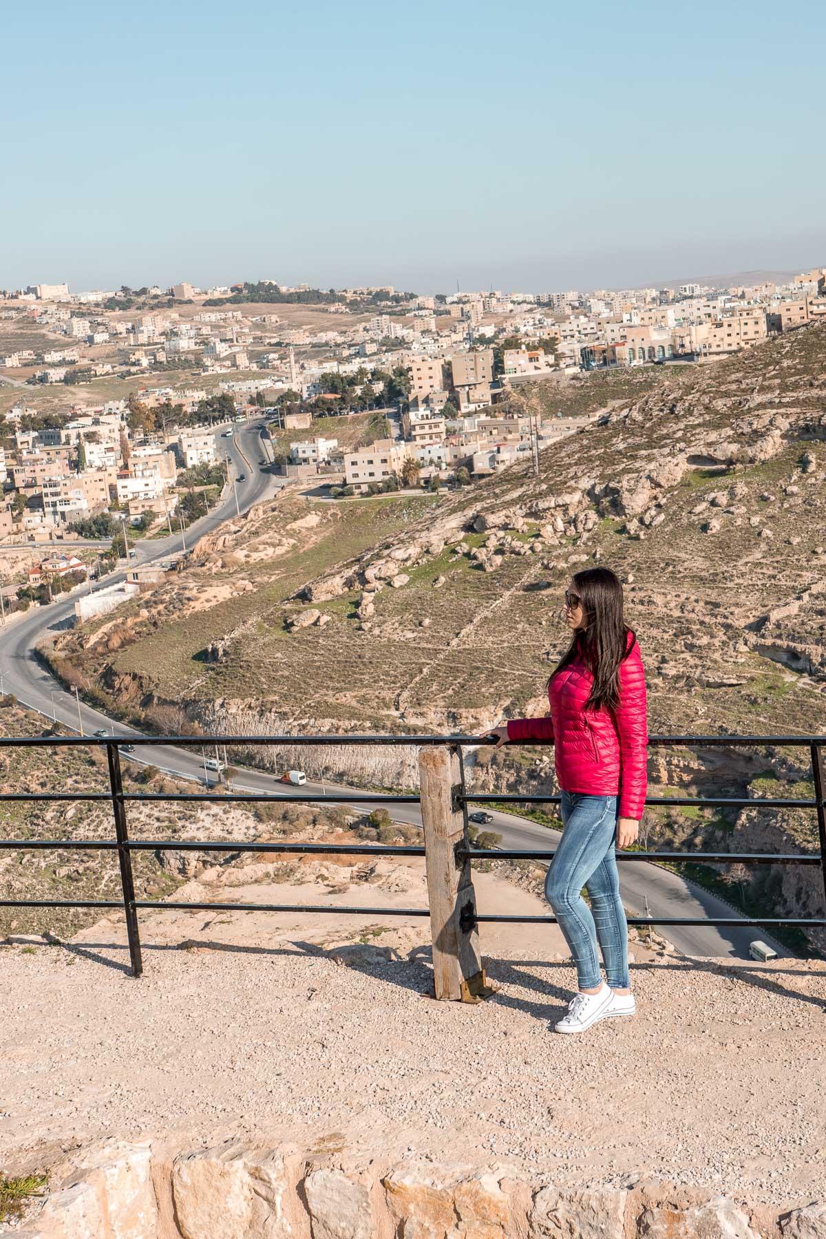 Girl in a pink jacket standing at the Kerak Castle in Jordan