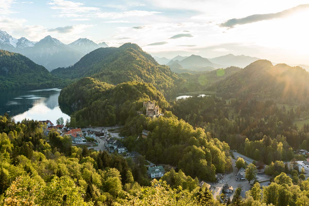 View of the Neuschwanstein Castle and the Hohenschwangau Castle from an upper viewpoint at sunset