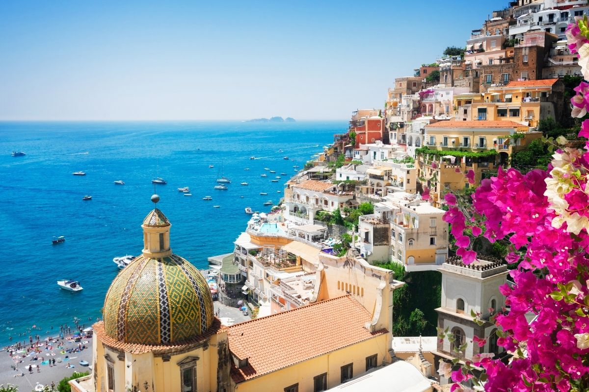 Panoramic view of Positano with flower in the Amalfi Coast in Italy