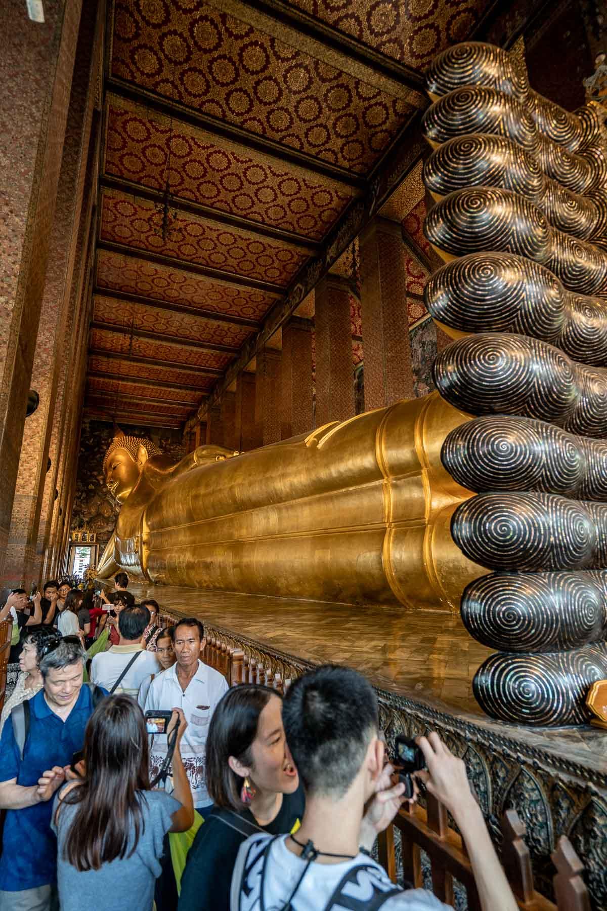 The huge reclining Buddha statue at Wat Pho in Bangkok