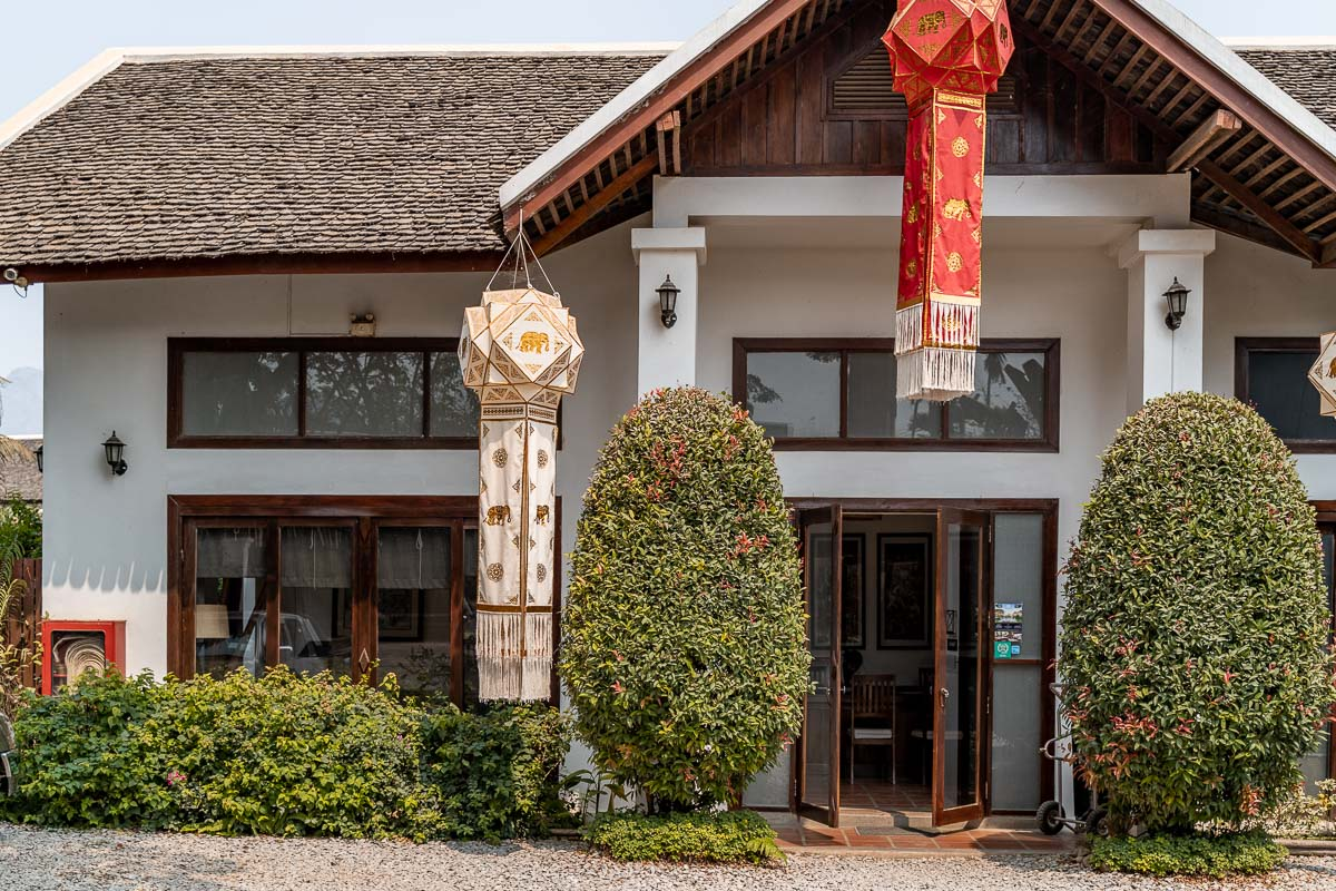 The entrance from the street to Riverside Boutique Resort Vang Vieng
