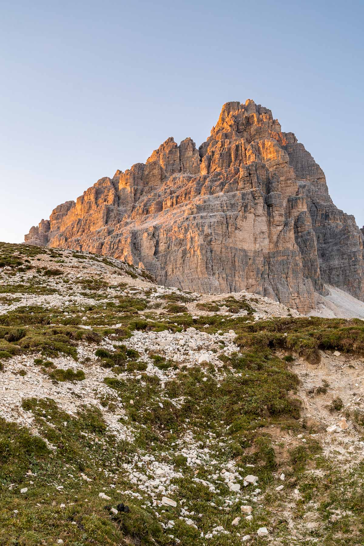 Sunset at Tre Cime di Lavaredo, which is a must visit on every Dolomites road trip itinerary