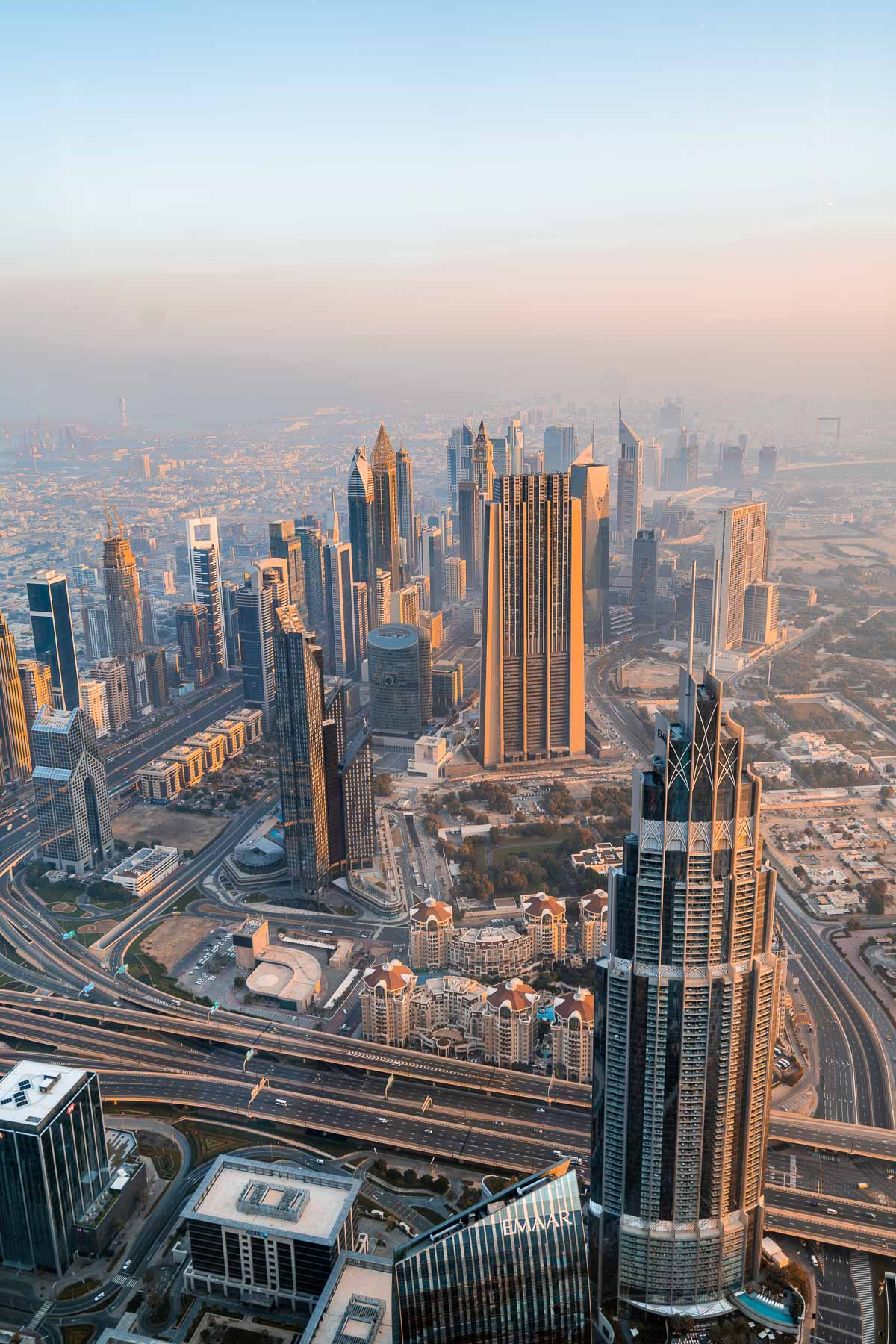 View of the Dubai skyline from the Burj Khalifa at sunrise