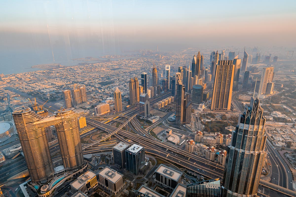 View of the Dubai skyline from the Burj Khalifa at sunrise