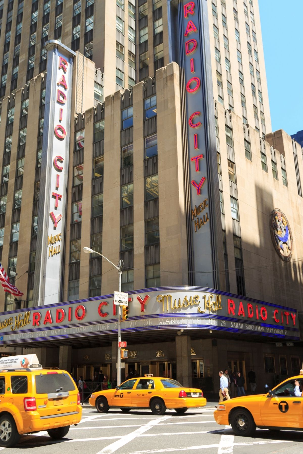 Yellow cabs in front of the Radio City Music Hall in NYC