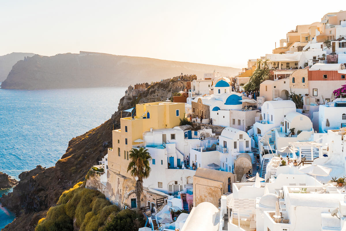 The postcard perfect view with the white washed cliffside buildings in Oia, Santorini